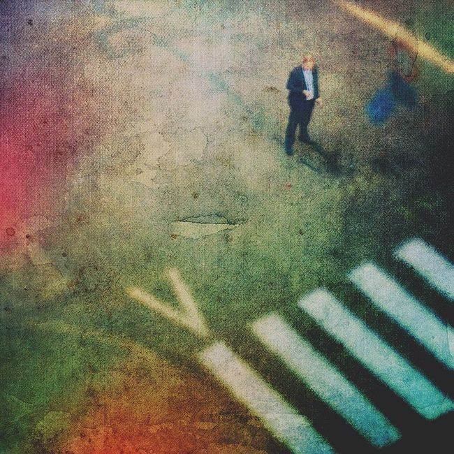 Small Scenes Of Life Street Crossing Man Looking At Mobile Alone Standing City