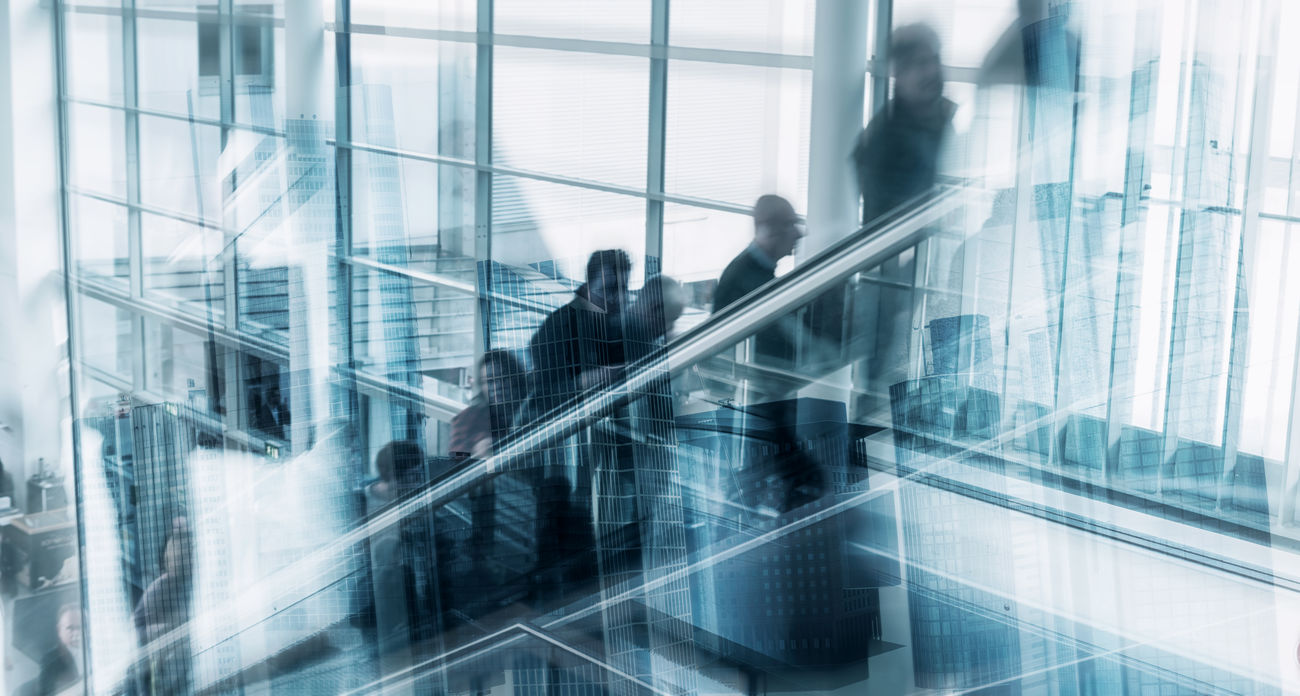 Abstract Image of Business People on a escalator Architecture Blurred Motion Business Business Finance And Industry Business Person Businessman Businesswoman City Escalator Exibition Glass - Material Indoors  Lifestyles Men Modern Motion Office Rush Rush Hour Staircase Steps Togetherness Unrecognizable Person Walking Window