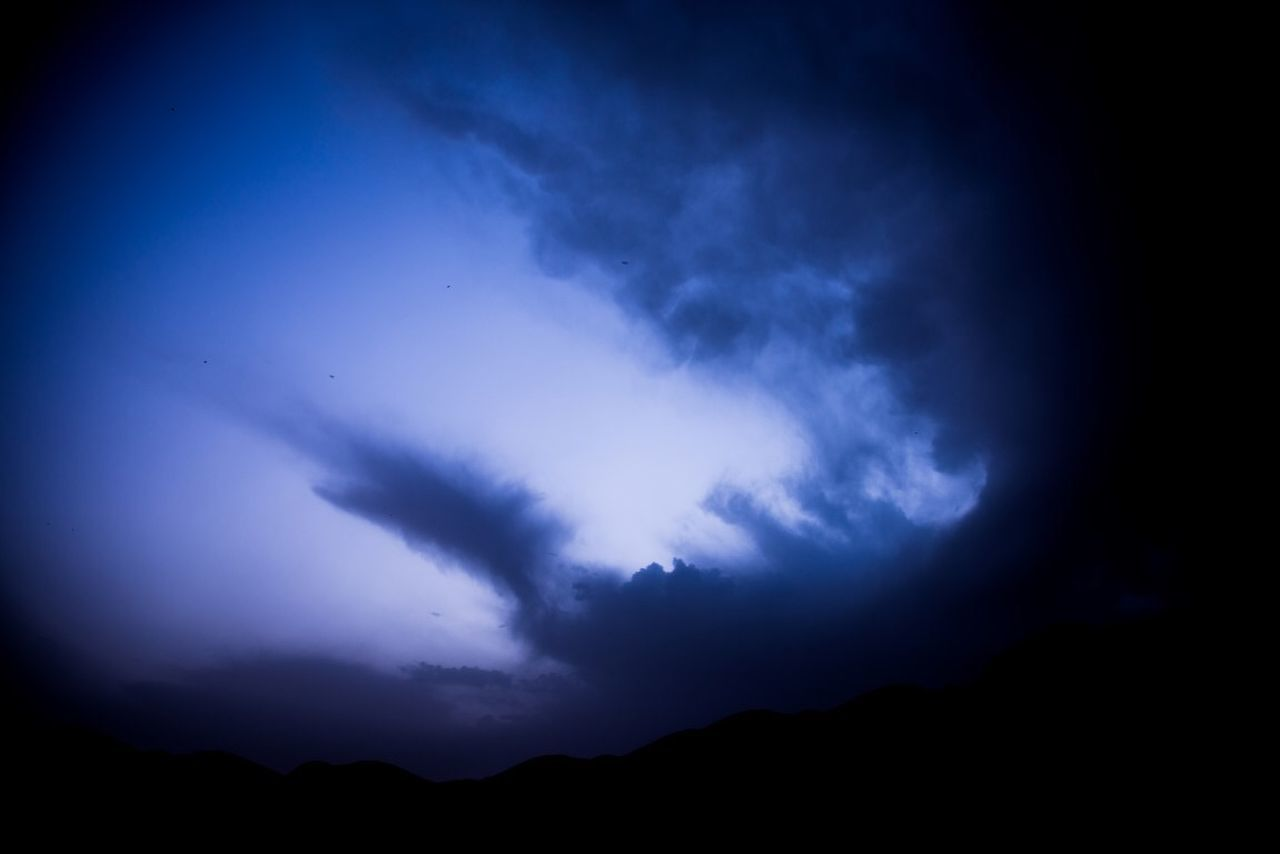 silhouette, night, nature, beauty in nature, sky, scenics, no people, tranquility, tranquil scene, cloud - sky, blue, mountain, lightning, outdoors, power in nature, thunderstorm, forked lightning, astronomy