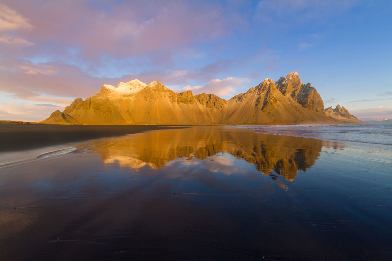 Reflections in Stokksnes Beach Beauty In Nature Black Sand Beach Cloud - Sky Day Enjoying Life Golden Hour Golden Light Iceland Morning Morning Light Mountain Mountain Range Nature No People Outdoors Reflection Scenics Sea Silence Sky Stokksnes Tranquil Scene Tranquility Water