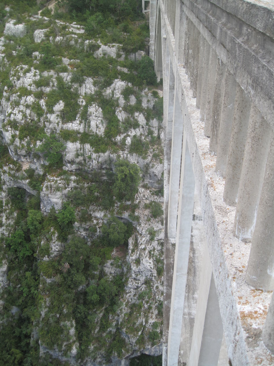 architecture, built structure, connection, dam, road, hydroelectric power, bridge - man made structure, transportation, day, tree, outdoors, water, no people, nature