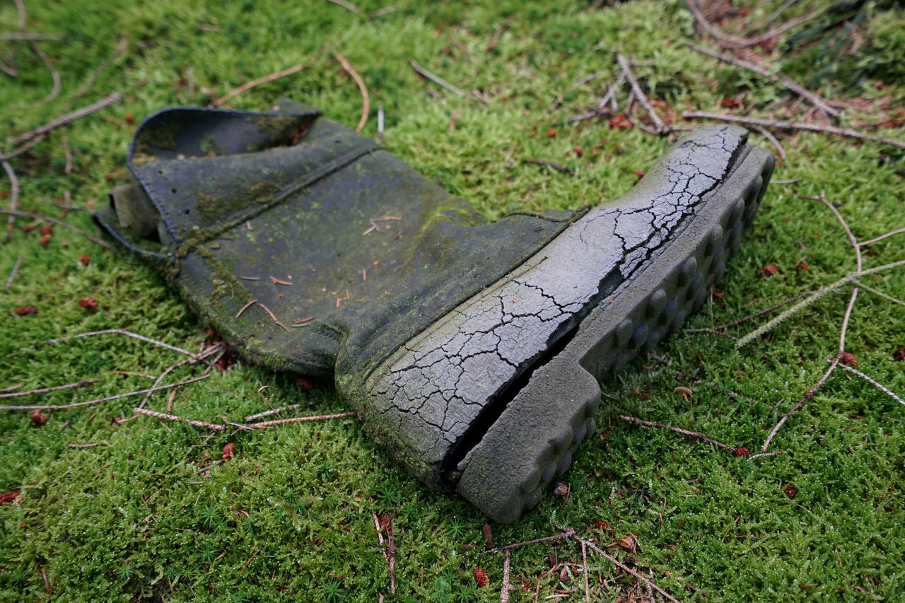 Lost and found Abandoned Boots Damaged Day Field Focus On Foreground Grass Grassy Green Color Lost Moss No People Obsolete Old Outdoors Past Times  Weathered