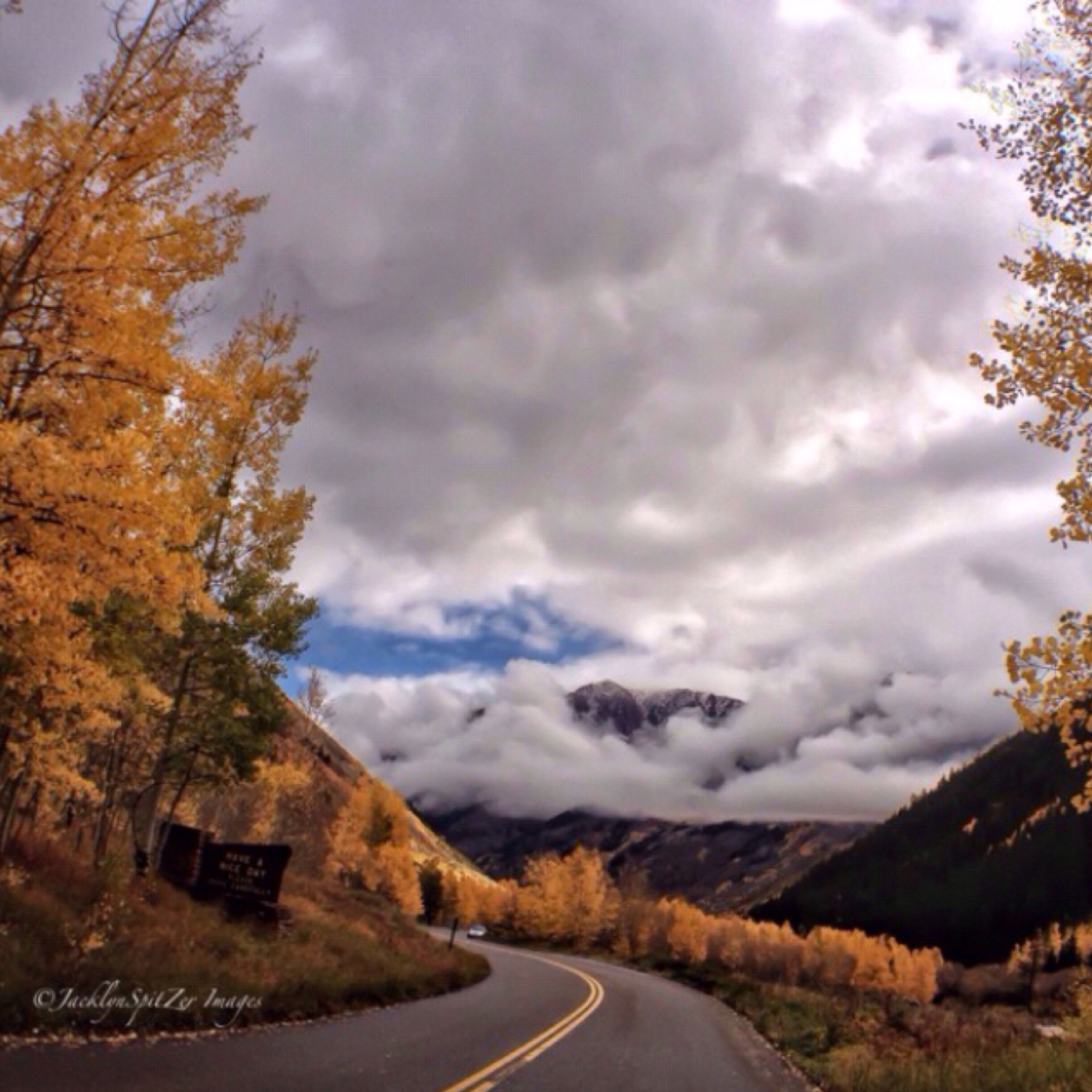 the way forward, road, sky, transportation, cloud - sky, country road, diminishing perspective, tree, cloudy, road marking, vanishing point, mountain, empty road, tranquil scene, scenics, tranquility, cloud, landscape, nature, street