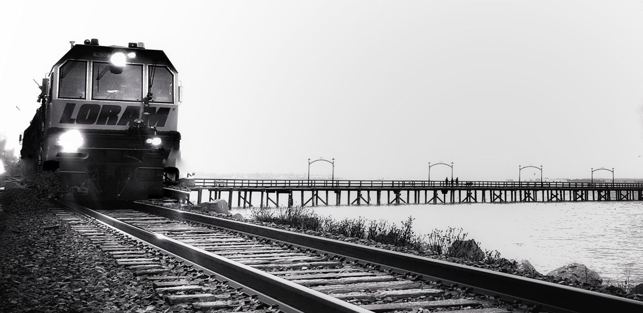 transportation, railroad track, rail transportation, mode of transport, train - vehicle, public transportation, clear sky, travel, freight transportation, outdoors, locomotive, day, sky, steam train, nature, no people