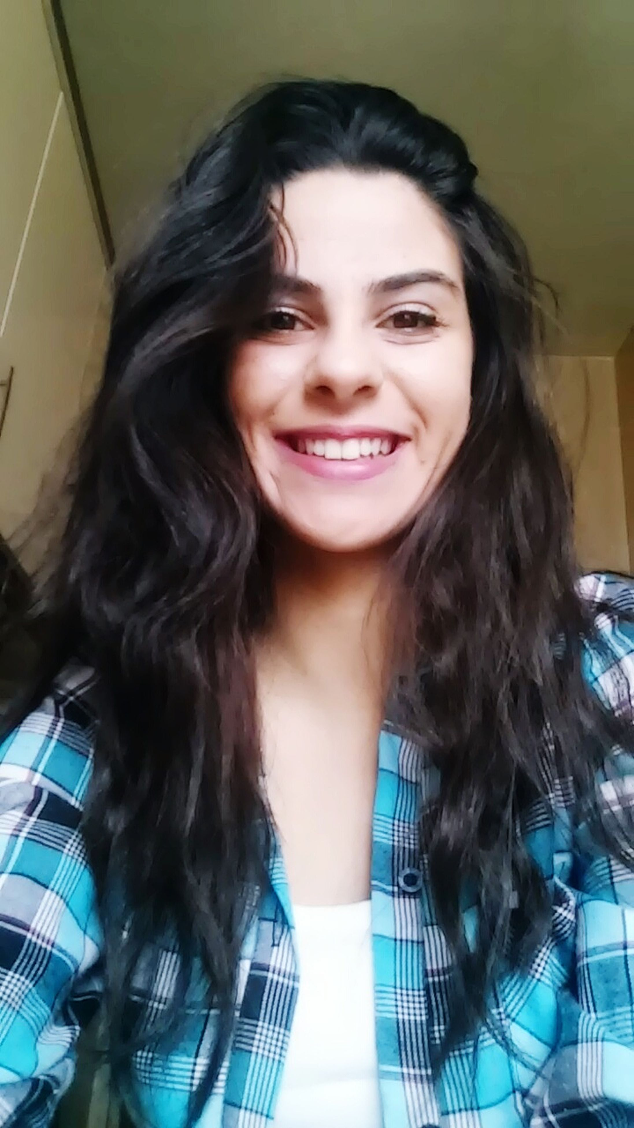 portrait, looking at camera, young adult, person, young women, lifestyles, indoors, front view, long hair, leisure activity, smiling, casual clothing, headshot, happiness, waist up, toothy smile