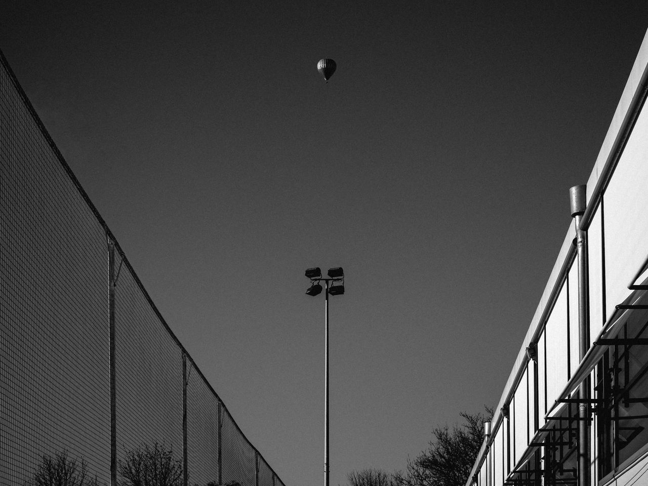 Mono Me Balloon Blackandwhite Clear Sky Connection Copy Space Development Engineering Flag Hanging Hot-air Balloon Identity Lighting Equipment Low Angle View Modern Monochrome Perspective Pole Railing Staircase Street Light Structure