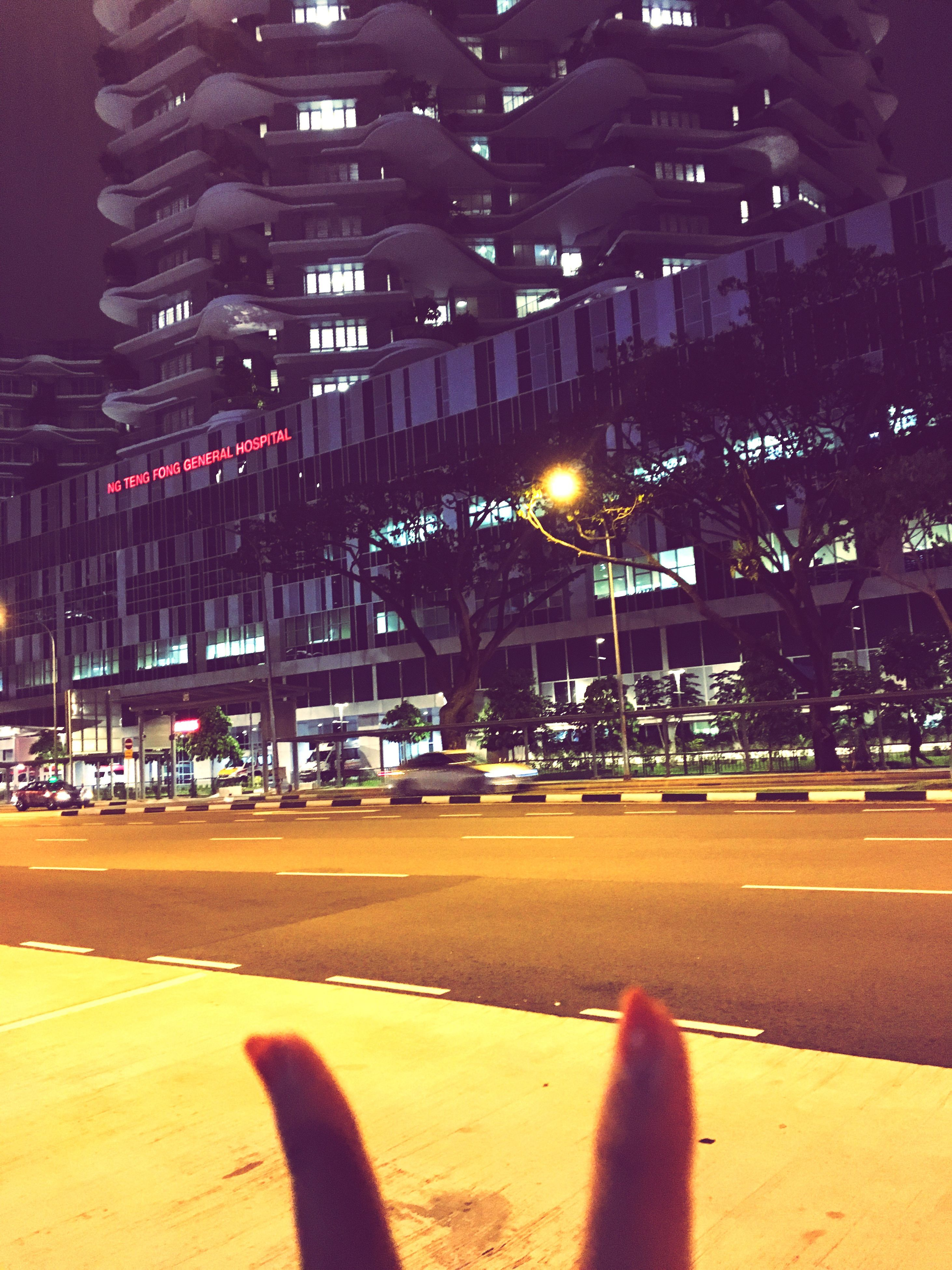 building exterior, architecture, city, built structure, city life, personal perspective, lifestyles, unrecognizable person, illuminated, night, men, low section, leisure activity, street, person, outdoors