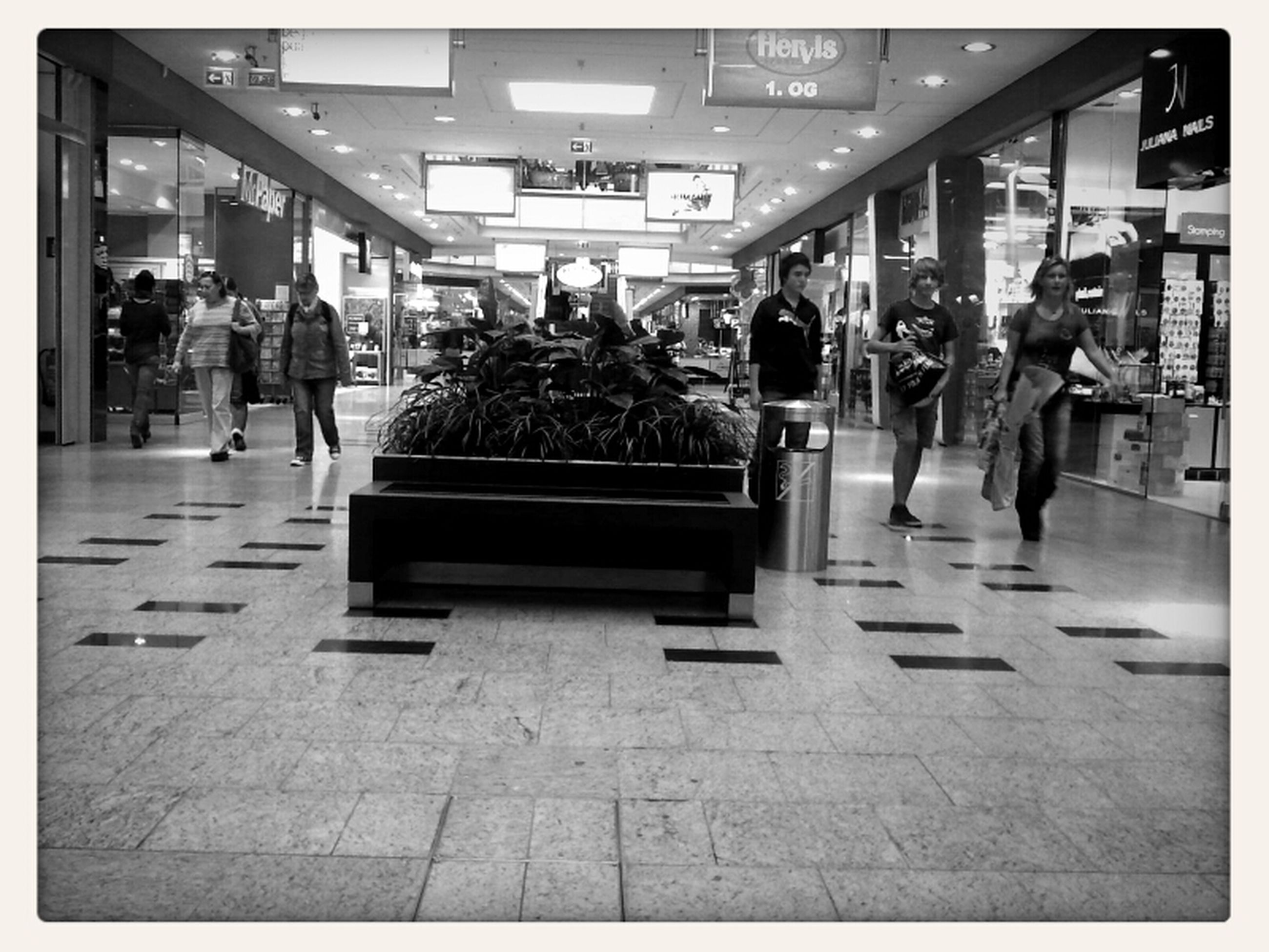person, men, large group of people, architecture, lifestyles, built structure, transfer print, walking, city, city life, building exterior, indoors, leisure activity, shopping, retail, tiled floor, full length, auto post production filter, glass - material