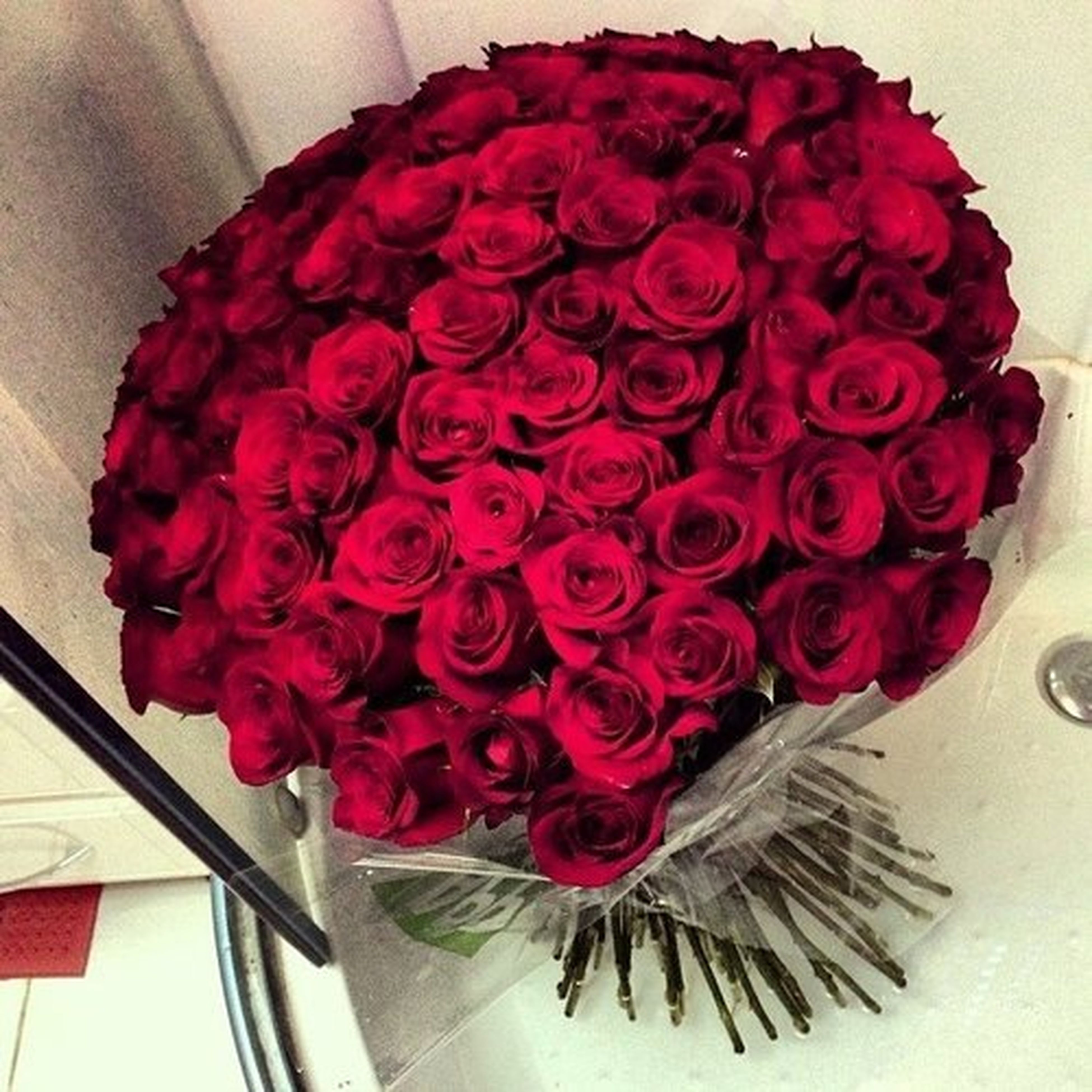 indoors, flower, freshness, table, red, vase, petal, high angle view, decoration, still life, fragility, home interior, close-up, pink color, flower head, bouquet, flower arrangement, no people, rose - flower, bunch of flowers