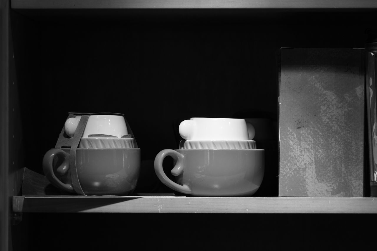 coffee cup, cup, drink, food and drink, indoors, refreshment, no people, coffee - drink, shelf, black background, teapot, close-up, teamwork, freshness, day