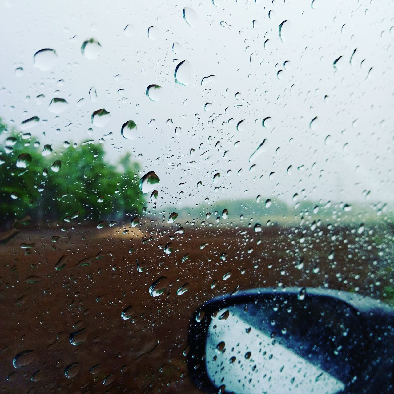 drop, wet, rain, window, glass - material, rainy season, water, raindrop, vehicle interior, weather, car, no people, car interior, land vehicle, windshield, transportation, mode of transport, indoors, sky, day, looking through window, nature, close-up