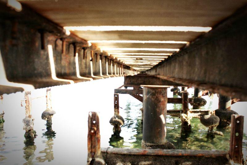 Under the bridge No People Sea Water Architectural Column