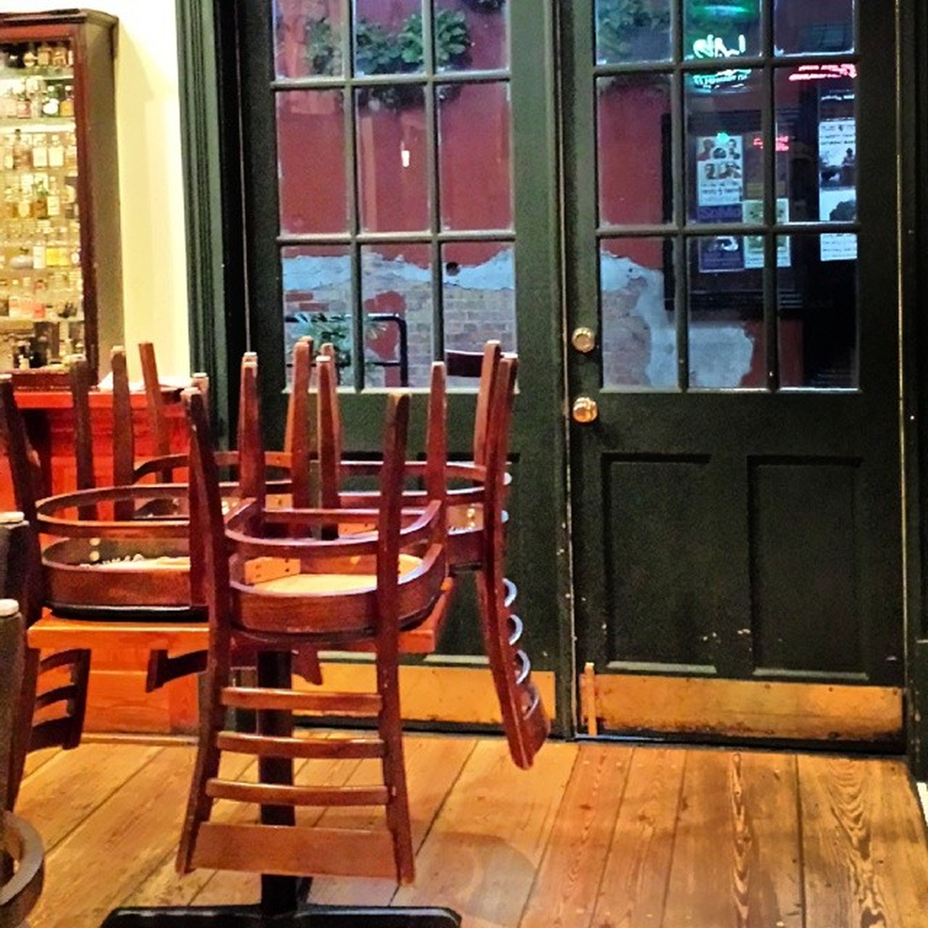 indoors, chair, table, wood - material, absence, home interior, window, furniture, empty, house, architecture, built structure, seat, hardwood floor, flooring, door, no people, restaurant, day, curtain