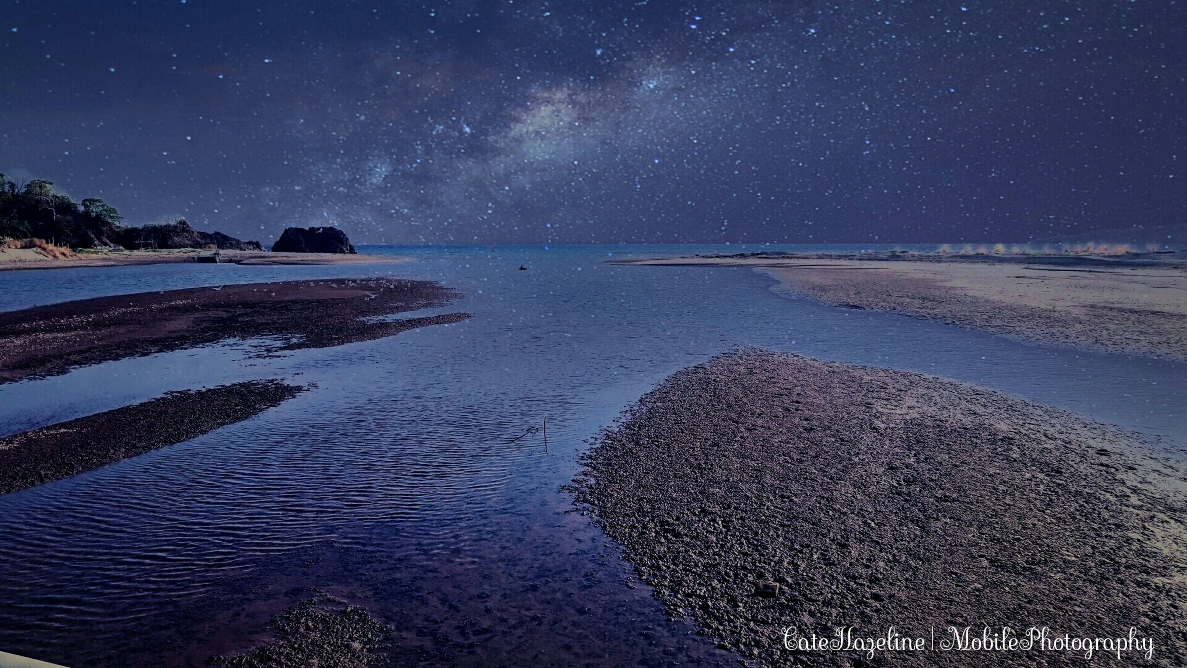 night, scenics, tranquil scene, tranquility, water, beauty in nature, sea, sky, nature, star - space, astronomy, idyllic, blue, beach, star field, majestic, outdoors, no people, star, remote