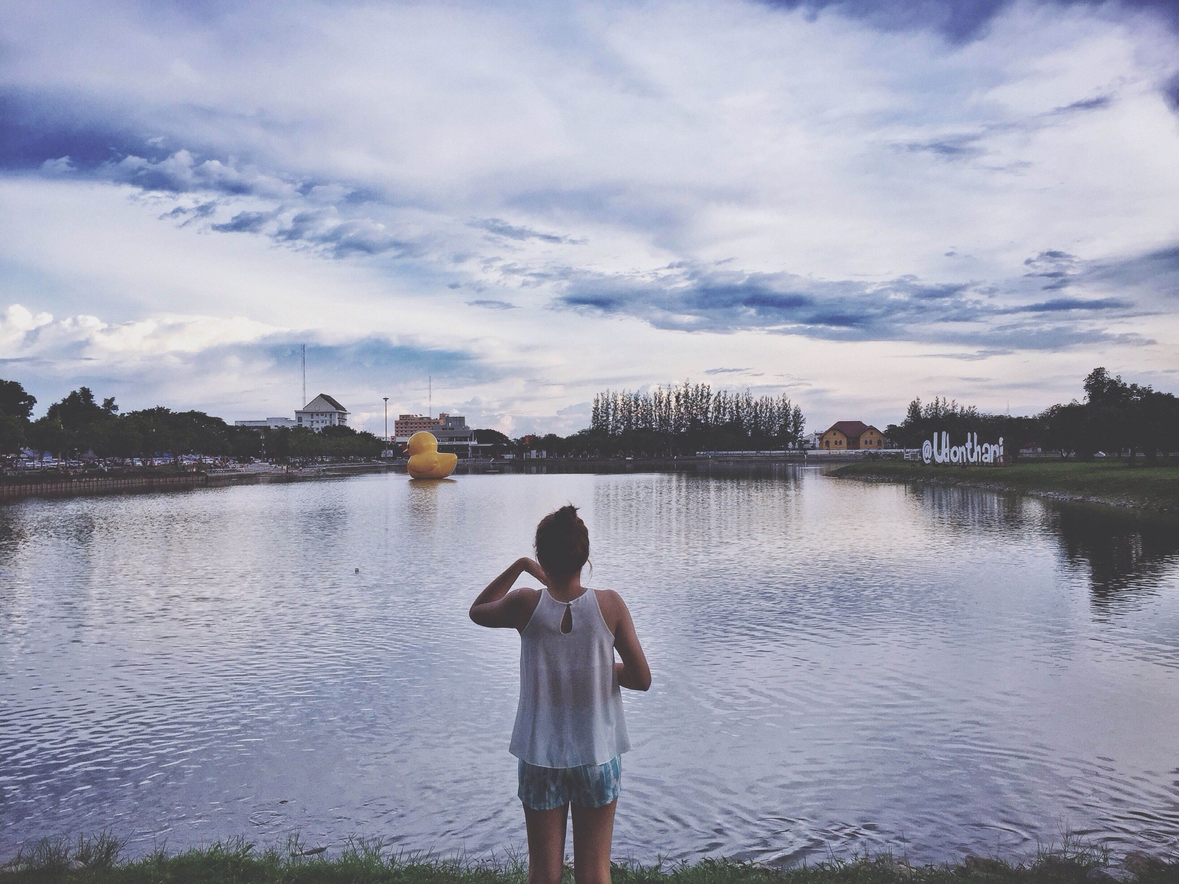 water, sky, lake, standing, lifestyles, leisure activity, casual clothing, cloud - sky, tranquility, nature, tranquil scene, cloud, scenics, beauty in nature, outdoors, lakeshore, day, idyllic