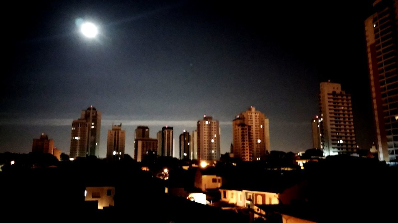 building exterior, night, architecture, illuminated, built structure, moon, skyscraper, city, sky, cityscape, no people, outdoors
