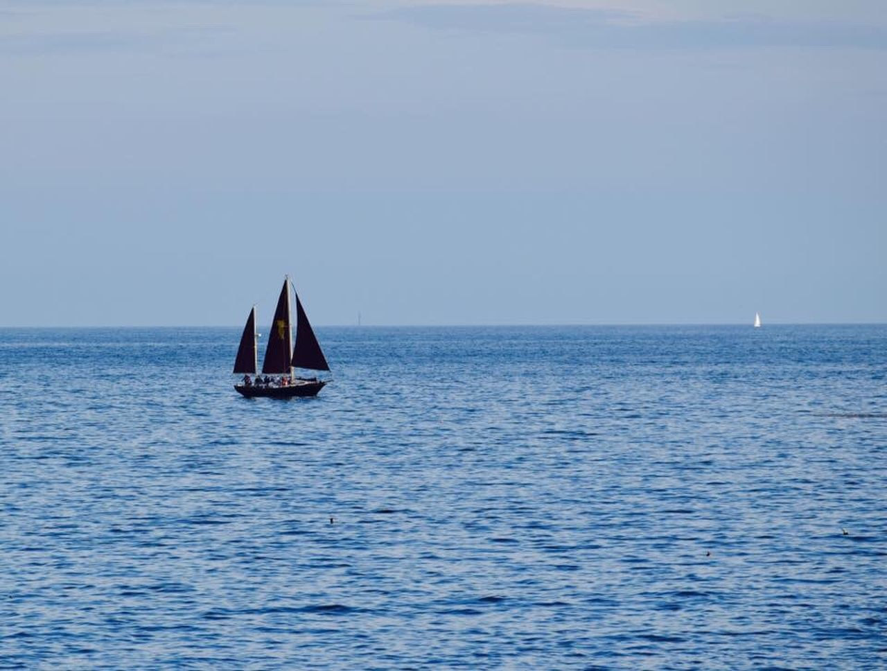 sea, sailboat, sailing, horizon over water, water, nautical vessel, waterfront, scenics, tranquility, tranquil scene, nature, clear sky, outdoors, day, beauty in nature, no people, blue, sky, mast, yacht, yachting