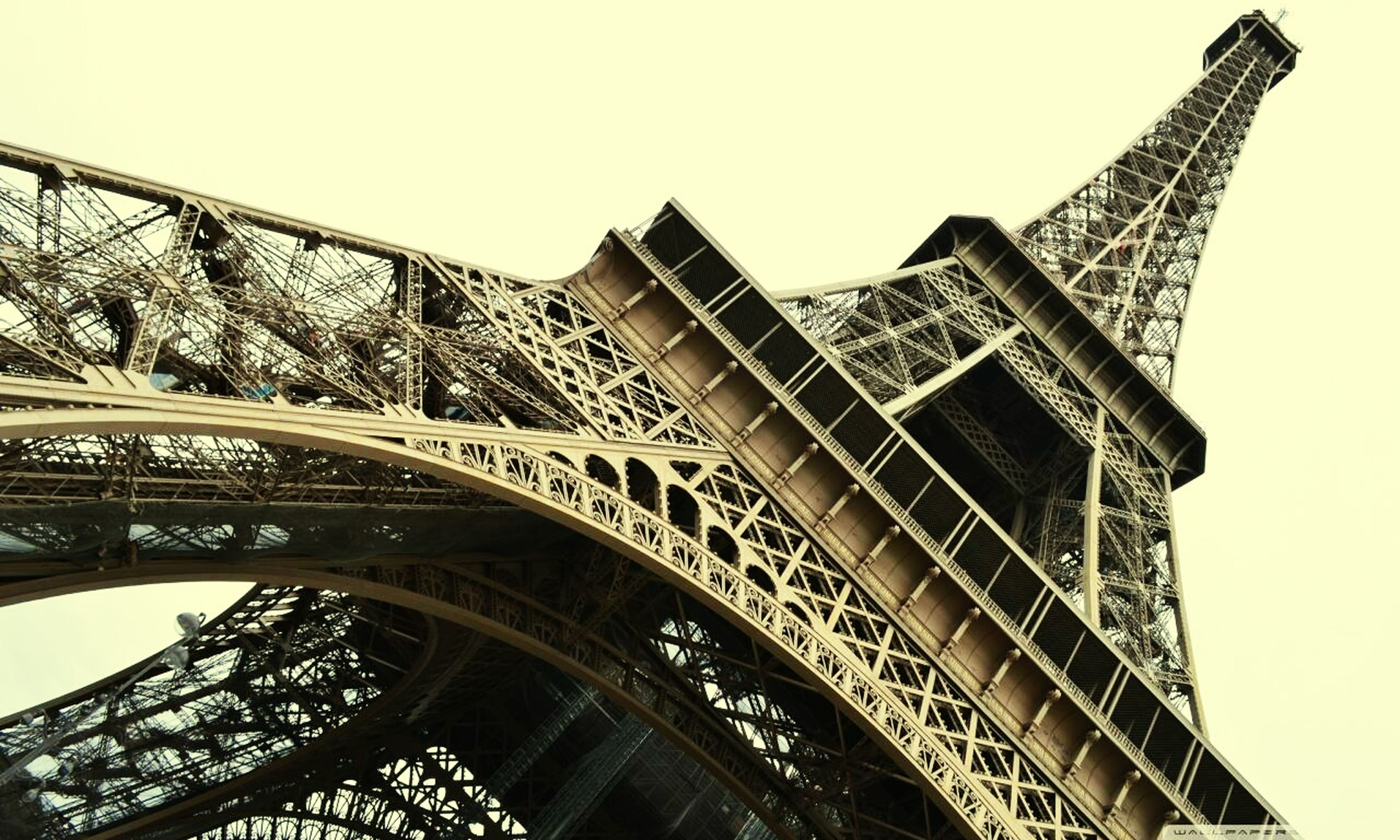 architecture, built structure, low angle view, clear sky, building exterior, tower, famous place, international landmark, eiffel tower, travel destinations, capital cities, tall - high, culture, architectural feature, city, tourism, travel, history, day, metal
