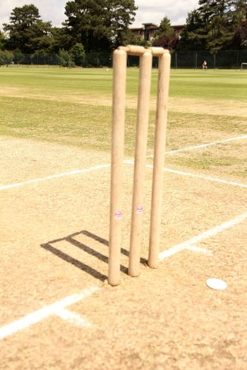 Cricket Cricket Pitch Cricket Stumps Day Grass Grassy Landscape Lawn No People No Players Shadow Sky Sunlight Sunny