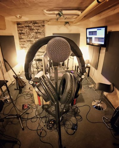 Music Recording Studio Sound Recording Equipment Technology Arts Culture And Entertainment Microphone Indoors  Audio Equipment Cable Headphones Connection Electrical Equipment Electronics Industry No People The Media Musical Instrument Radio Station Day