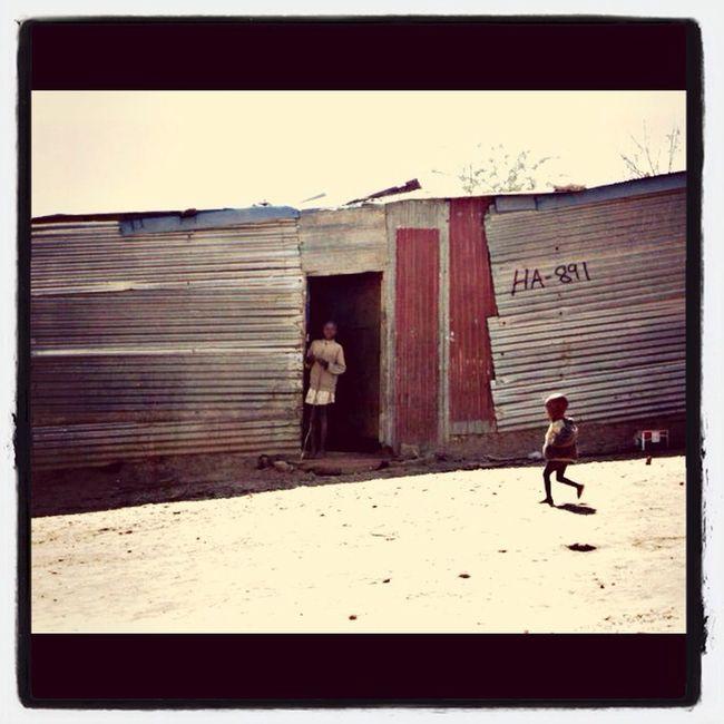 Random child strolling around Shanty Town The Struggle Landscape Life Nature