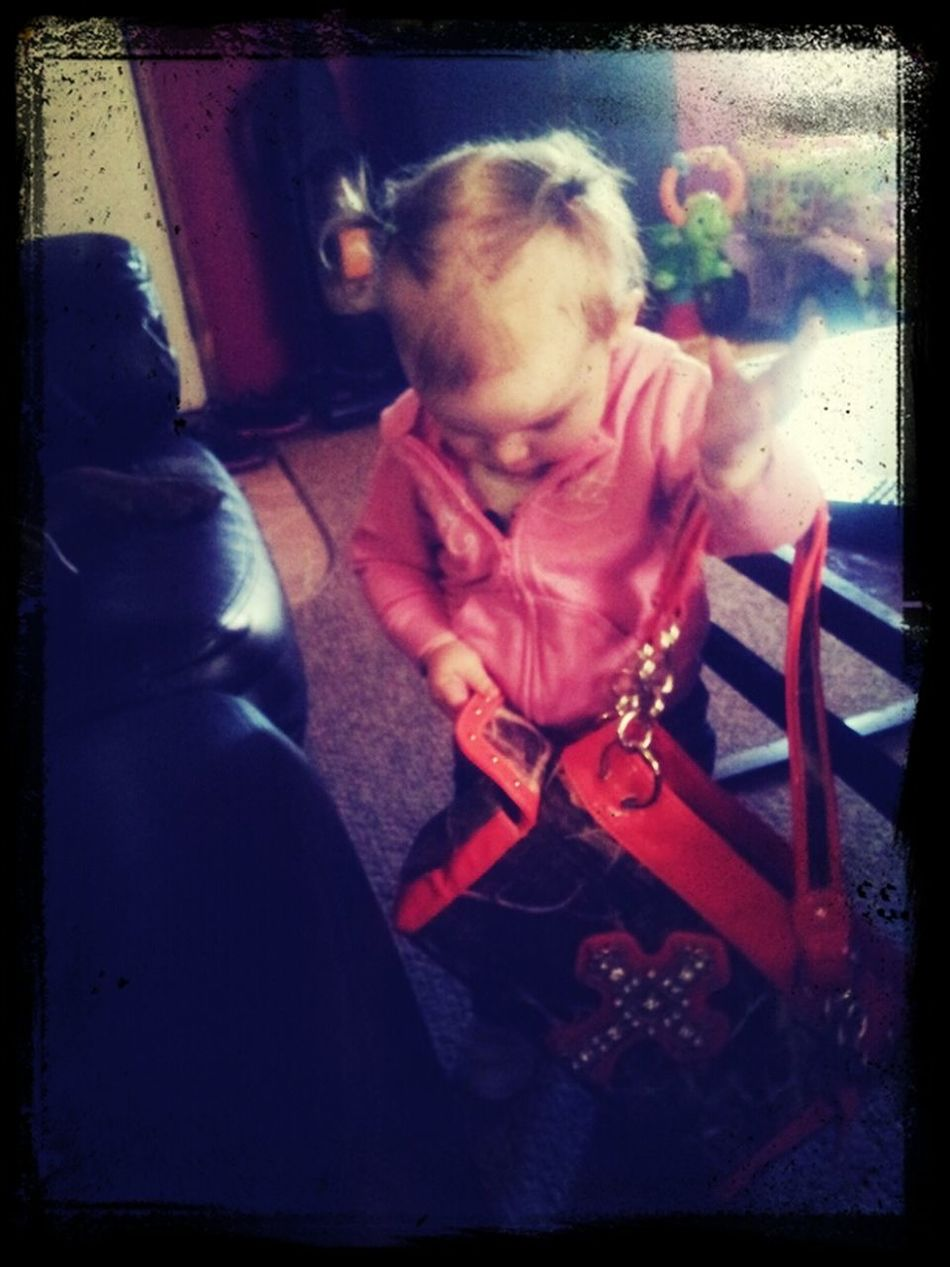 Taelynn with my purse :)))