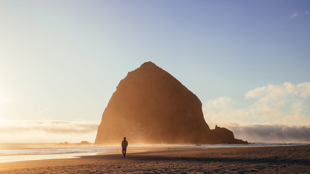 On Cloud Fine Adventure Beauty In Nature Beauty In Nature Cannon Beach My Year My View Nature One Person Oregon Outdoors People Real People Silhouette Sunset Tourism Vacations Warm Finding New Frontiers