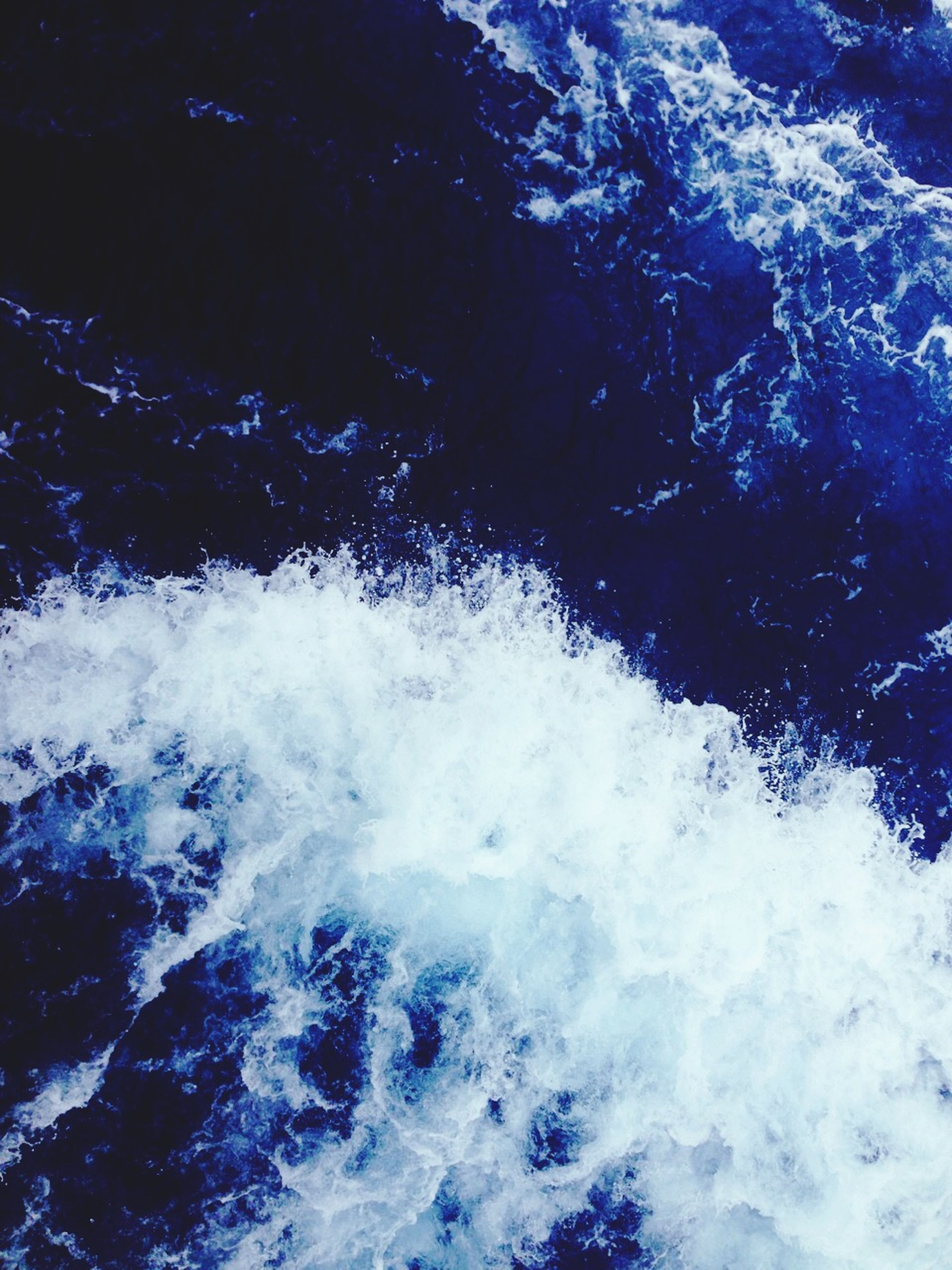 water, surf, motion, sea, wave, nature, beauty in nature, waterfront, splashing, high angle view, power in nature, day, outdoors, scenics, no people, flowing water, close-up, rock - object, white color, tranquility