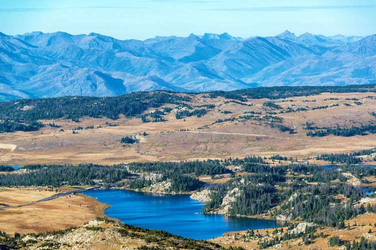Dramatic landscape with a lake and Beartooth Mountain Range in Montana and Wyoming Alpine Bear Montana Scenic Shoshone Travel Tundra USA Wyoming Beartooth Destination Forest Highway Landscape Mountain Mountain Range Mountains National Forest Overlook Peaks Plateau Redlodge Tooth Valley Wilderness
