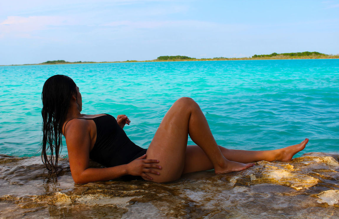 Beauty In Nature Day Full Length Leisure Activity Lifestyles LumiereStudios Nature One Person Outdoors People Real People Relaxation Sea Sitting Sky Water Women Young Adult Young Women