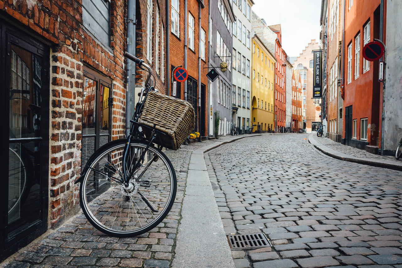 Architecture Basket Bicycle Building Exterior Built Structure City City Life Cobblestone Copenhagen Europe Mode Of Transport No People Outdoors Park Parking Retro Sidewalk Street Streetphotography Transportation Travel Urban Landscape Vintage