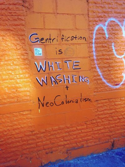 What We Revolt Against gentrification NYC Brooklyn Gentrification Colonization Painting Orange