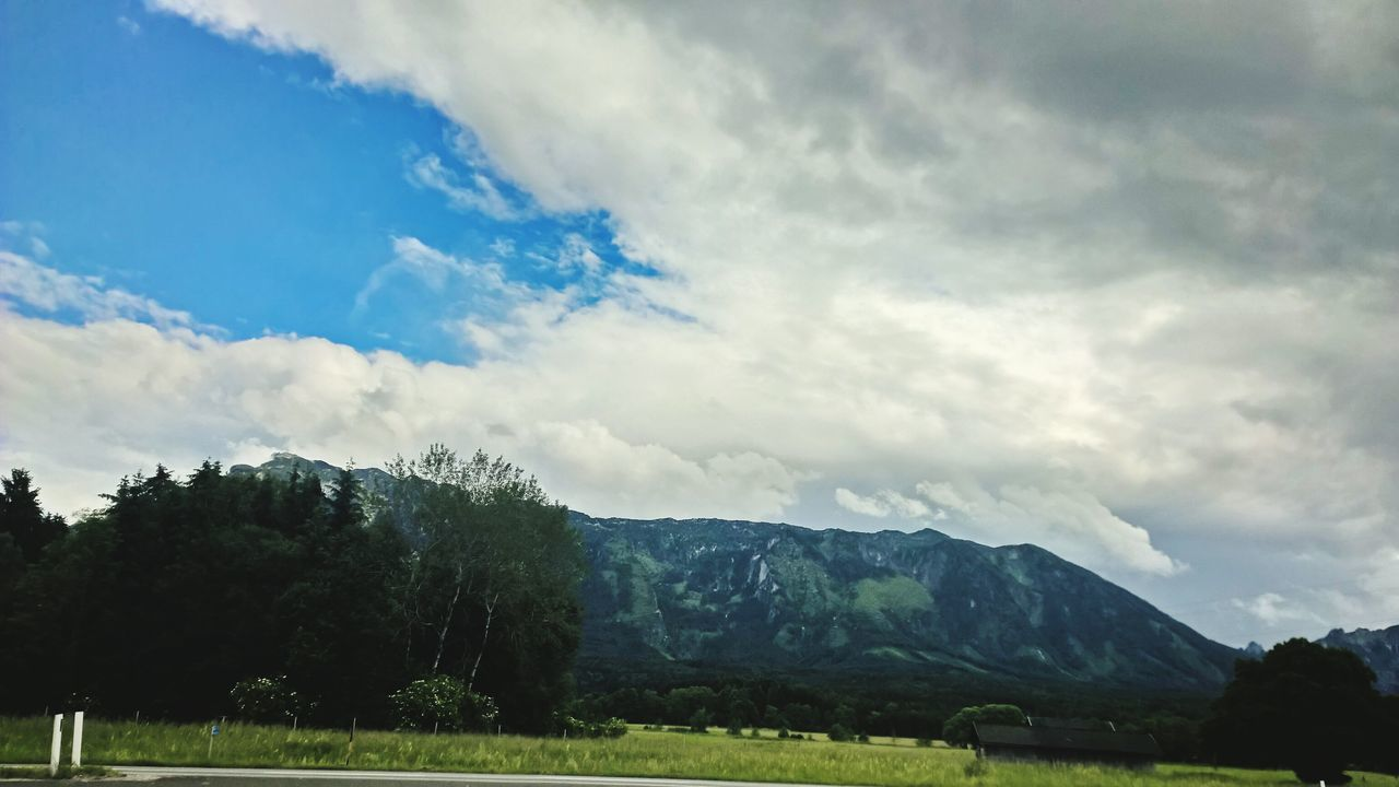 nature, sky, beauty in nature, tranquility, scenics, landscape, cloud - sky, tranquil scene, mountain, tree, no people, day, grass, outdoors