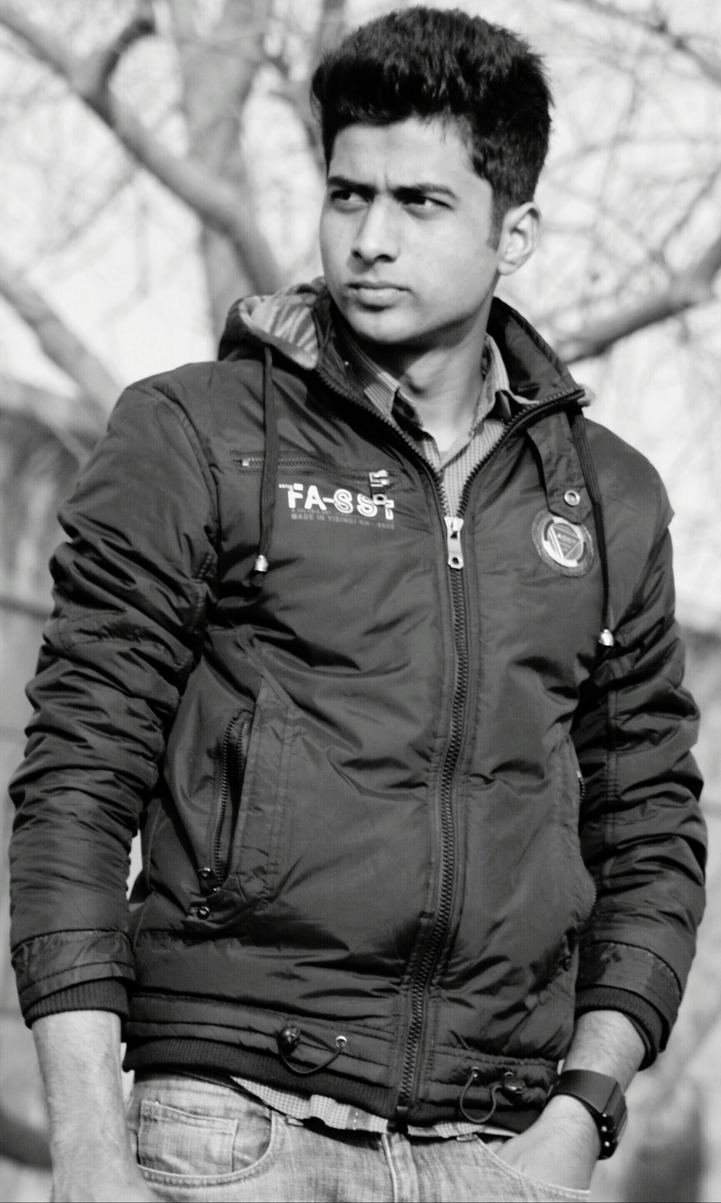 person, casual clothing, lifestyles, young adult, front view, leisure activity, portrait, looking at camera, focus on foreground, three quarter length, young men, standing, jacket, waist up, holding, smiling, warm clothing