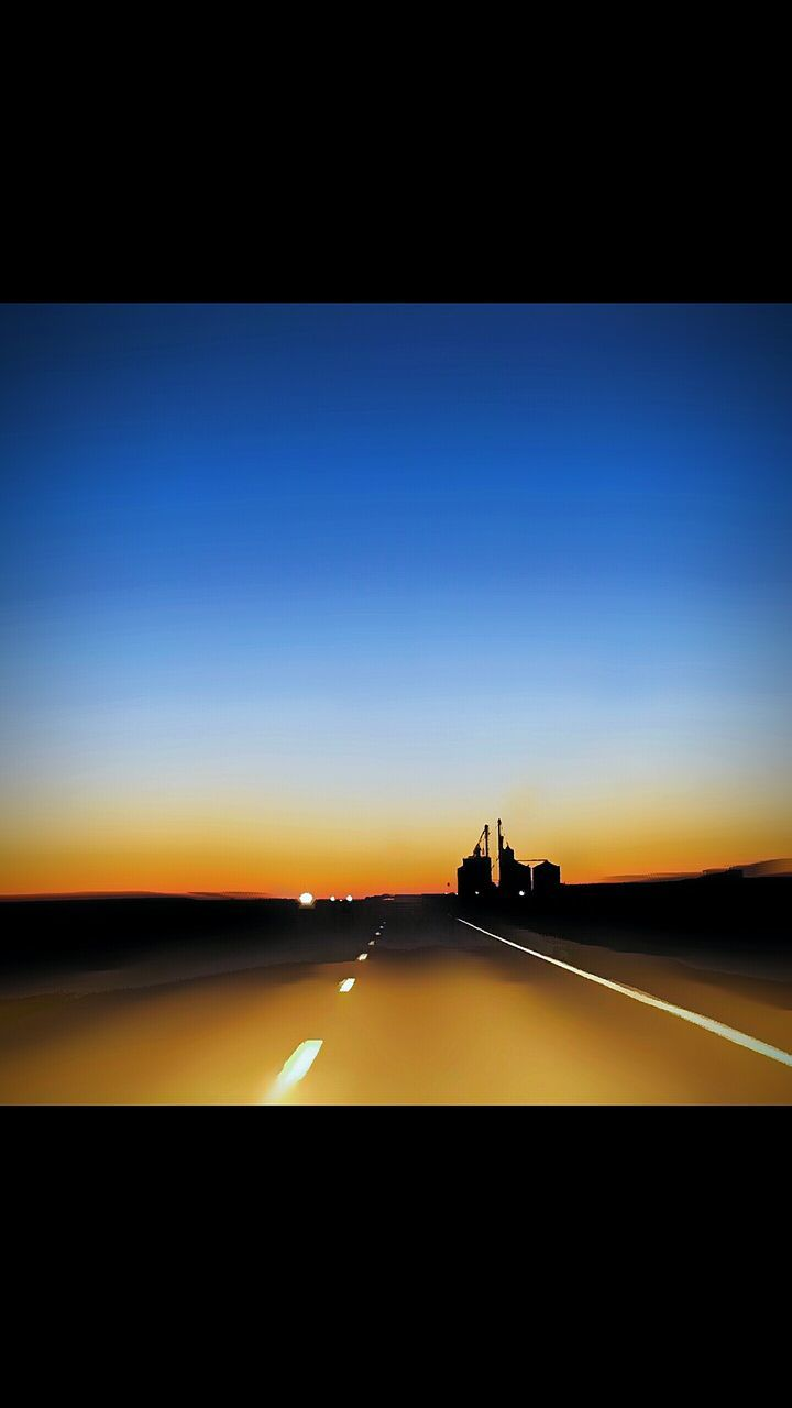 transportation, sunset, mode of transport, silhouette, land vehicle, car, road, no people, scenics, night, blue, sky, outdoors, illuminated, nature, water, city, beauty in nature