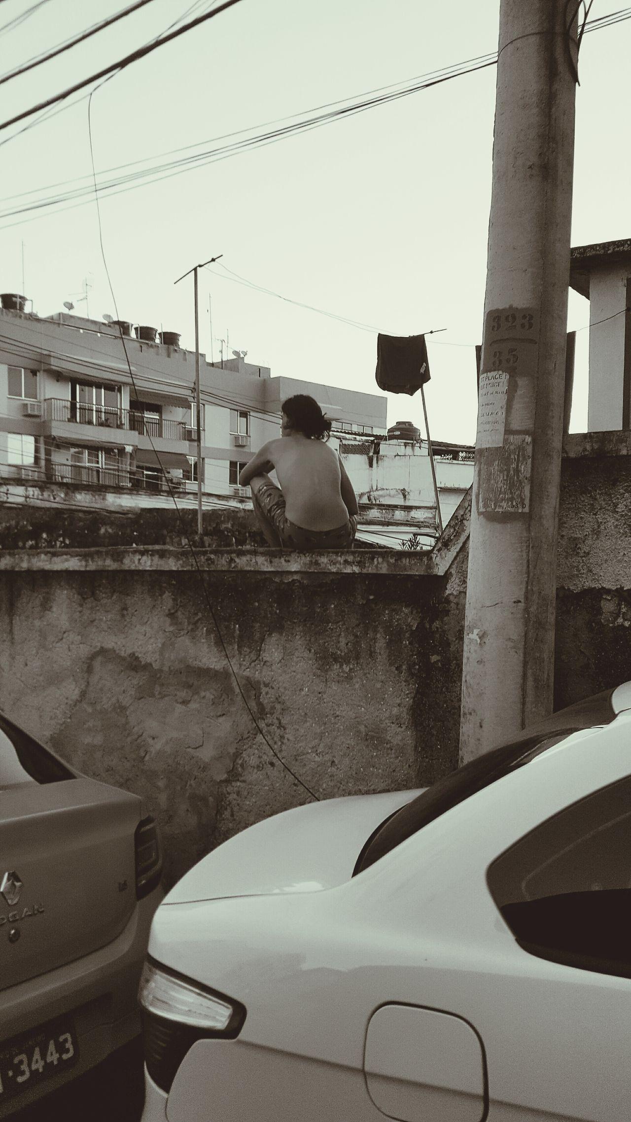 Watching Favela Rio De Janeiro Brazil Poverty Struggle Black And White Wall Sitting Man Hope Dreaming