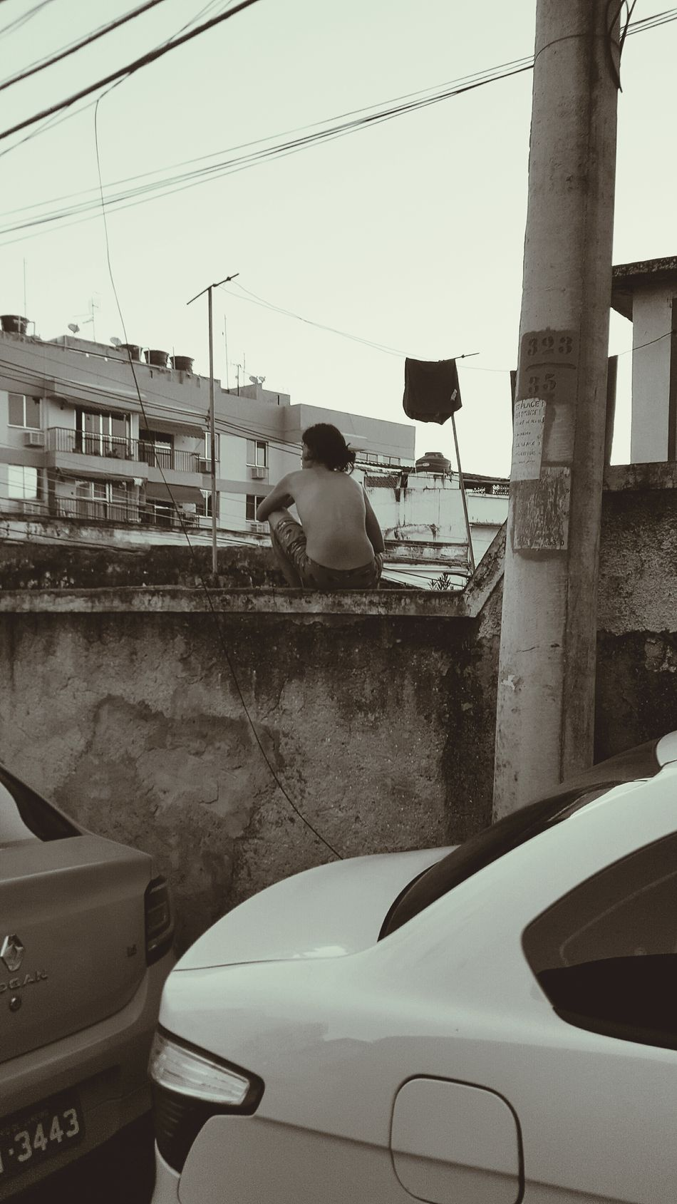 Watching Favela Rio De Janeiro Brazil Poverty Struggle Black And White Wall Sitting Man Hope Dreaming