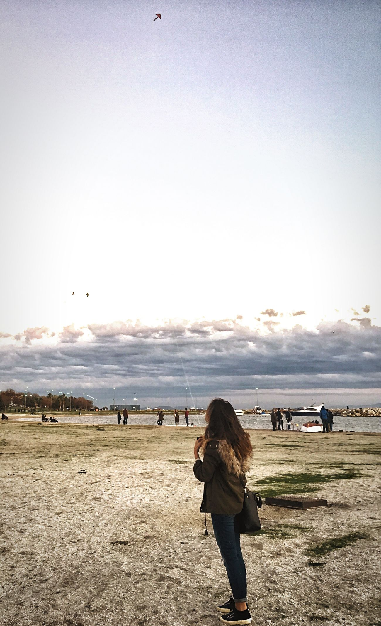Nature Real People Lifestyles Outdoors Walking Leisure Activity Rear View Clear Sky Beach Women Day Sky Nature Warm Clothing Beauty In Nature People Special Blue Sky Blue Kite Kitesurfing Kite Flying
