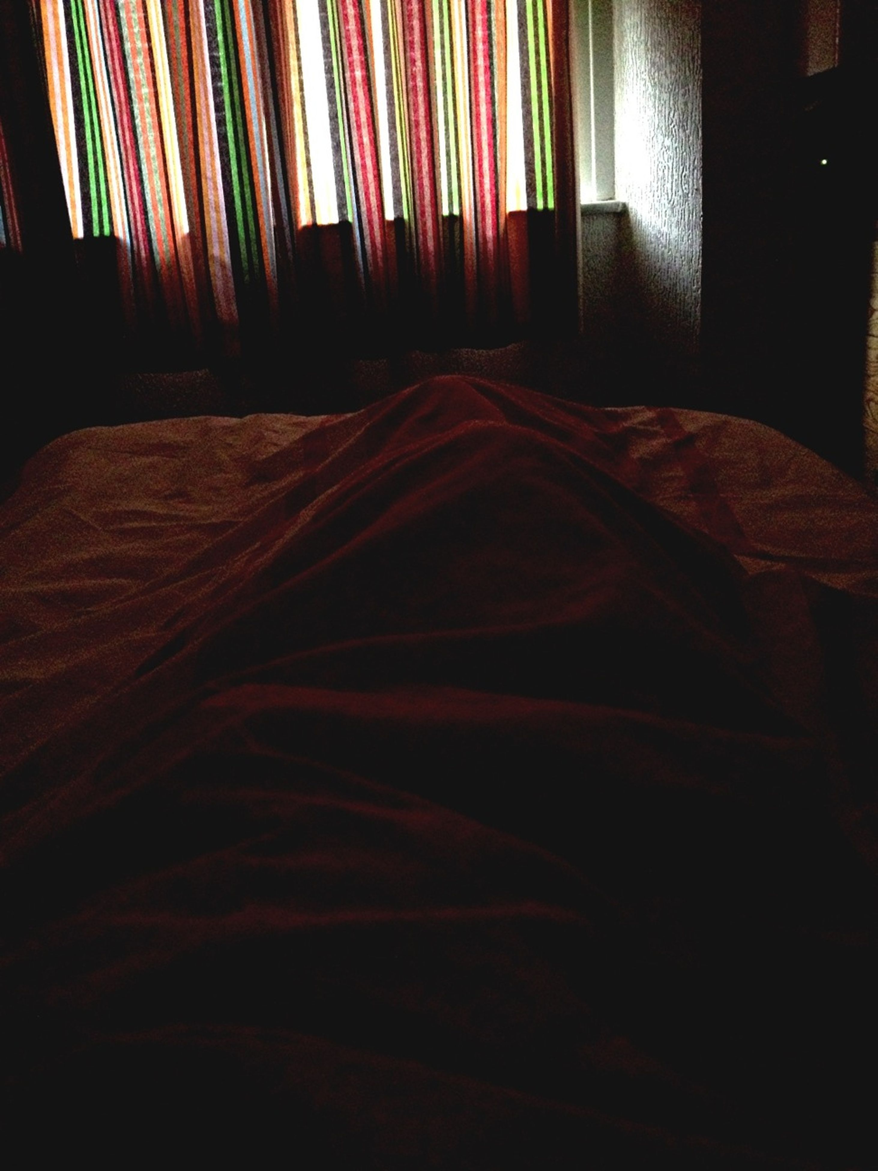 indoors, home interior, no people, pattern, bed, dark, curtain, window, absence, still life, close-up, fabric, house, textile, bedroom, room, table, design, wall - building feature, shadow