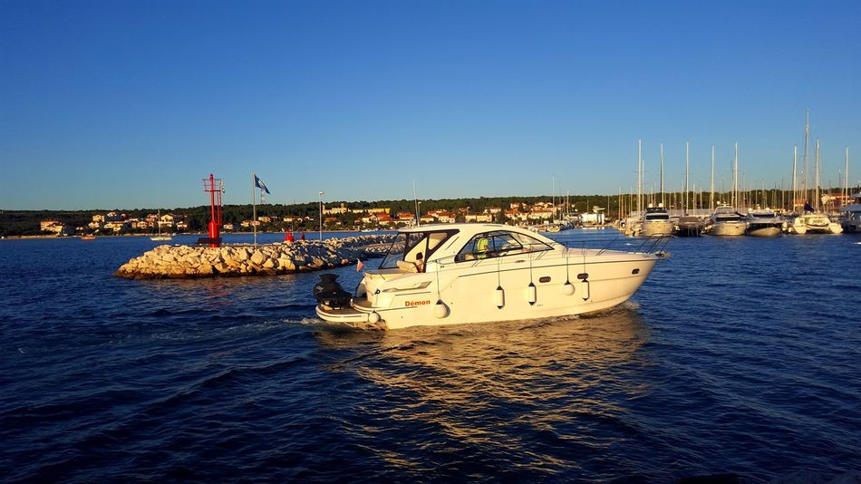 Water Nautical Vessel Sea Blue Transportation Tranquility Clear Sky Travel Destinations Horizontal Floating On Water Sailboat Sailing Beauty In Nature Idyllic Yachting Sailing Ship Aquatic Sport Adventure