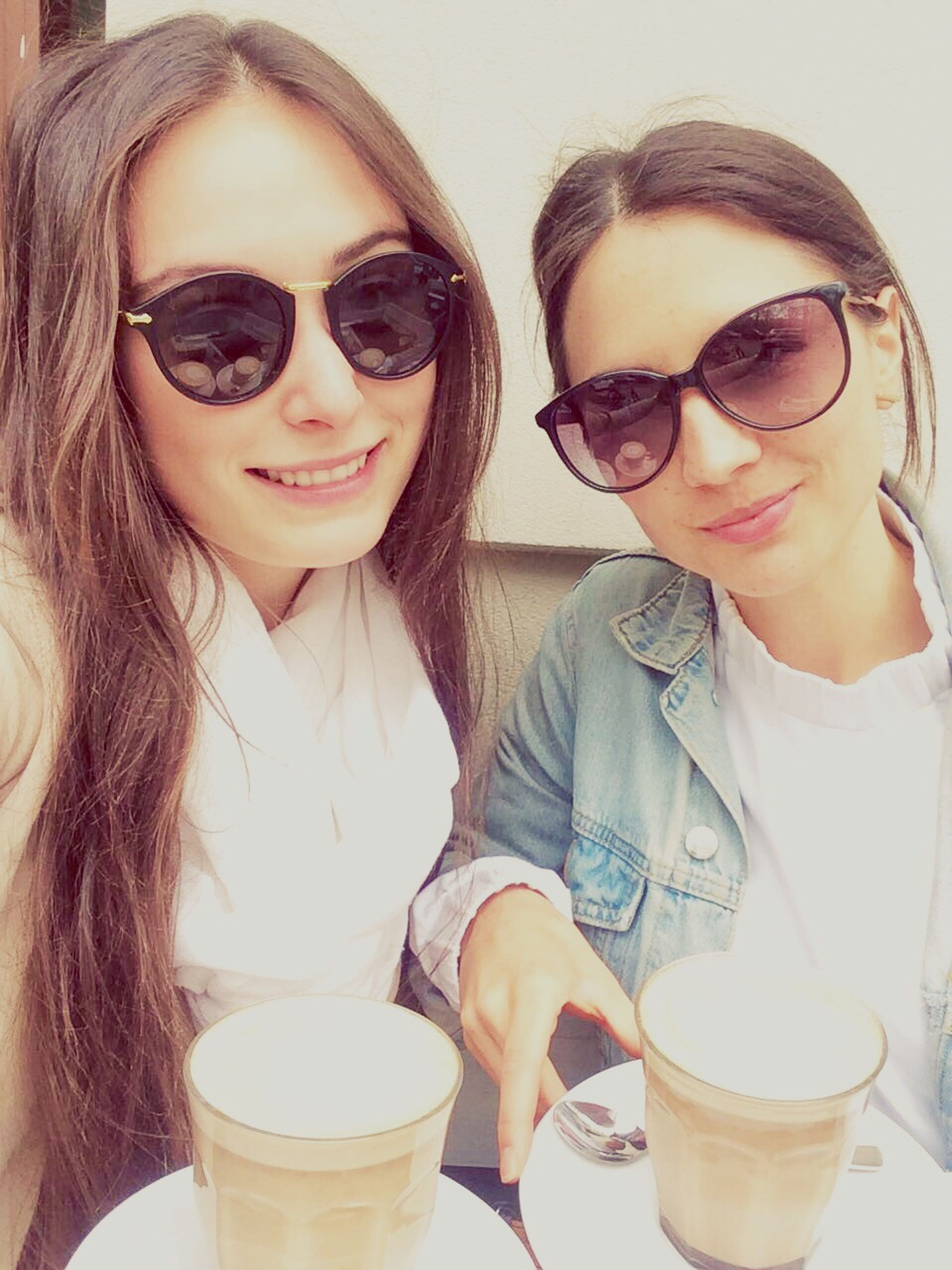 sunglasses, smiling, young adult, two people, coffee - drink, women, drink, beautiful people, espresso, togetherness, happiness, young women, adult, only women, adults only, people, cappuccino, beauty, friendship, portrait, cheerful, beautiful woman, outdoors, day, sky, latte