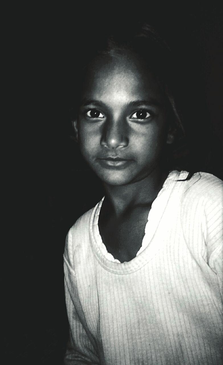 Close-Up Portrait Of Girl Standing In Dark