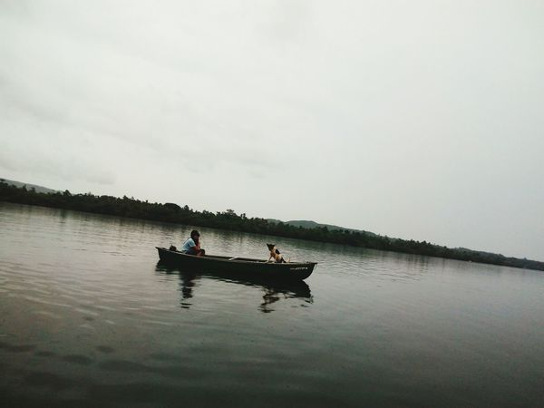 Water Lake Adult Sitting Men People Nautical Vessel Outdoors Nature Day Occupation Full Length Togetherness Sky Adults Only Rowing Beauty In Nature Only Men