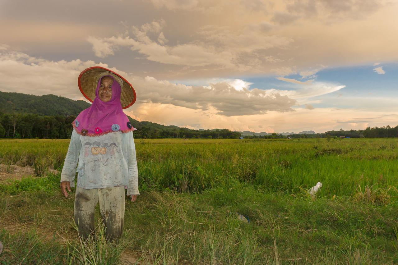 the old lady farmer Beauty In Nature Cloud - Sky Day EyeEmNewHere Field Full Length Grass Growth Landscape Nature One Person One Woman Only Outdoors Paddy Field People Real People Scenics Sky Standing Streetphotography Sunset The Great Outdoors - 2017 EyeEm Awards The Photojournalist - 2017 EyeEm Awards The Portraitist - 2017 EyeEm Awards The Street Photographer - 2017 EyeEm Awards