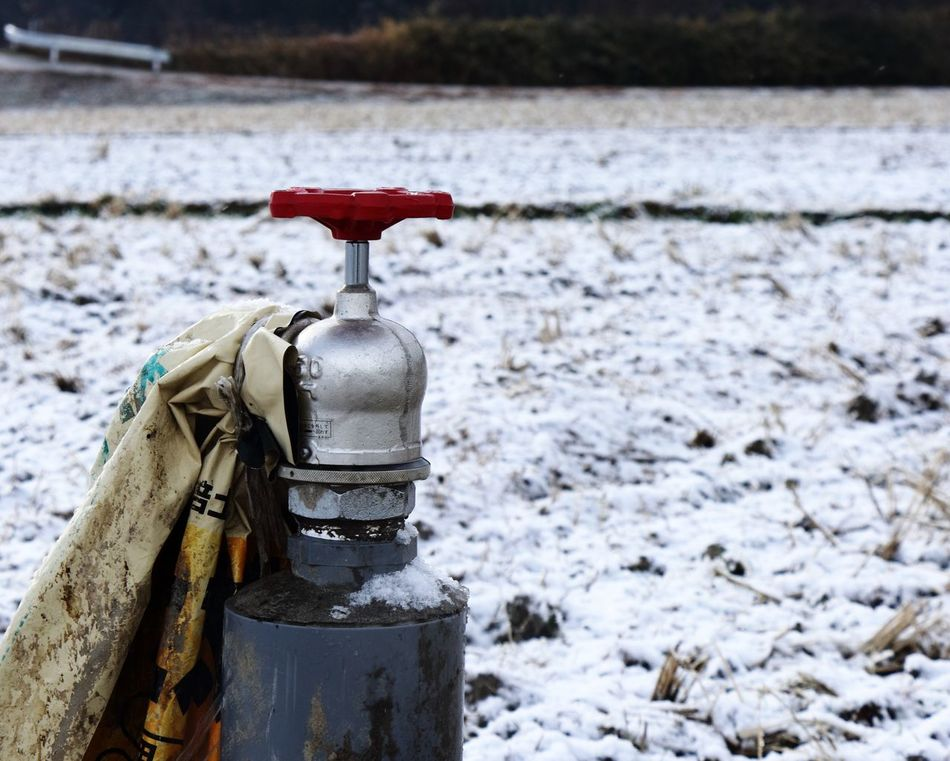 a Valve in the middle of a Snowy Morning