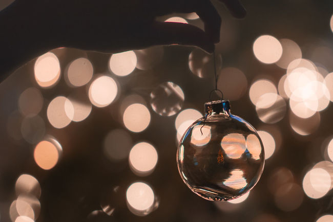 Christmas Bokeh Circle Close-up Crystal Ball Decoration Electric Light Fairy Lights Focus On Foreground Geometric Shape Glowing Hanging Illuminated Lens Flare Lighting Equipment Lit Multi Colored No People The Culture Of The Holidays