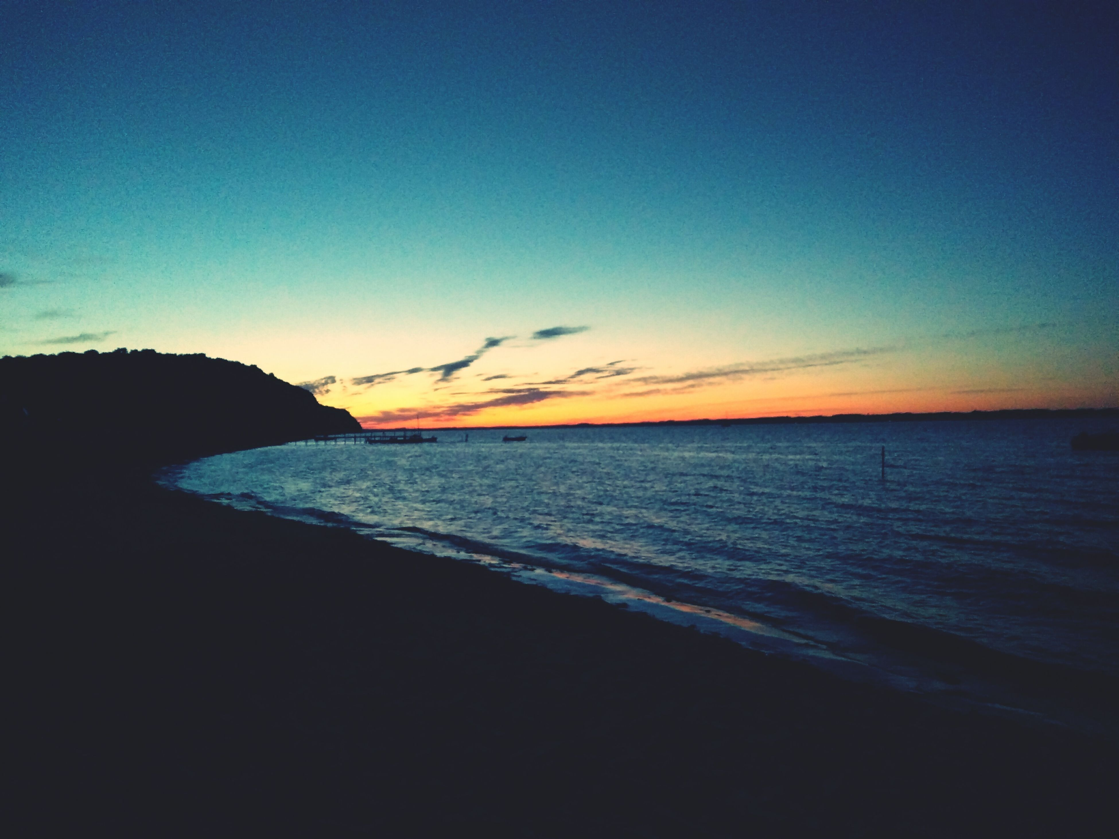 sea, sunset, beauty in nature, water, horizon over water, scenics, nature, sky, tranquil scene, tranquility, idyllic, silhouette, no people, beach, outdoors, day