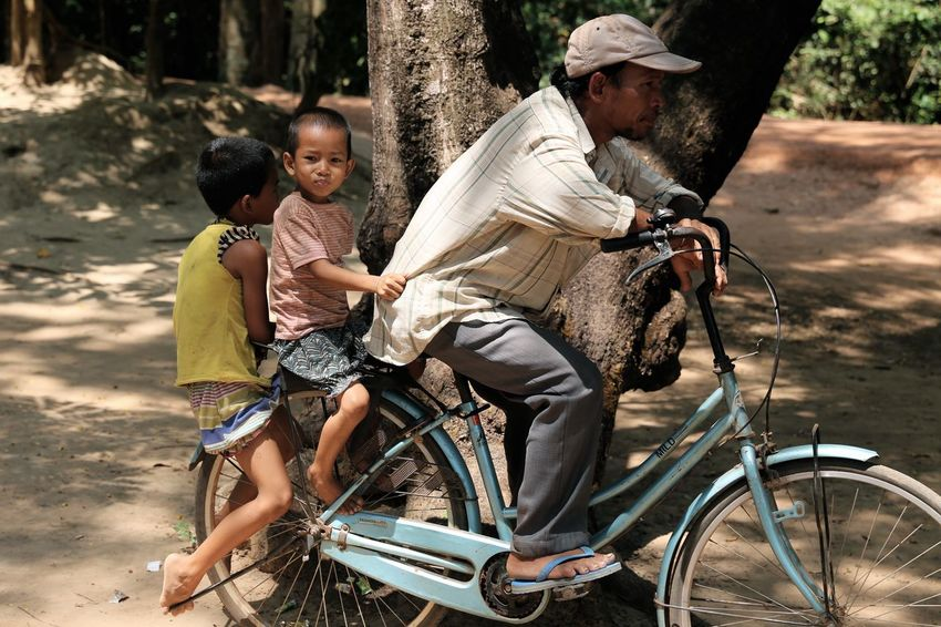 Innocence Of Youth Innocent Face Kid Photography Innocence Cambodia Cambodian Bicycle