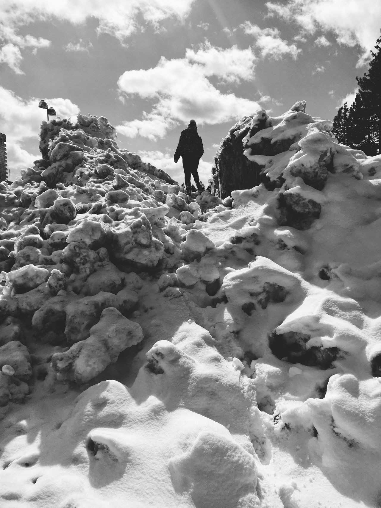 Sky Full Length Real People Rock - Object Lifestyles Nature Outdoors Day Leisure Activity Tranquility Beauty In Nature Vacations Cloud - Sky Scenics Black & White Cold Temperature Low Angle View One Person Snow