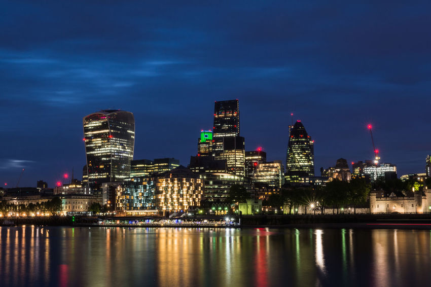 London cityscape at dusk Business Downtown Futuristic Growth Skyline Thames River Architecture Backgrounds Banking City Cityscape District Dusk England Financial Illuminated Modern Night Reflection Skyscraper Success Travel Destinations Uk Urban Skyline Water